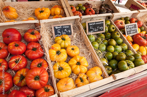 Fresh heirloom tomatoes  in the market of south France © flydragon