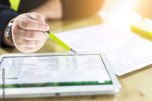 Accounting on a tablet computer, close-up Canvas Print