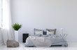 Leinwanddruck Bild - Large blank wall with unmade bed