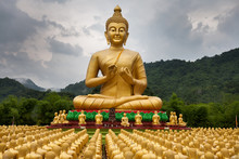 Golden Buddha Statues ,mountain,background , Raining Fog