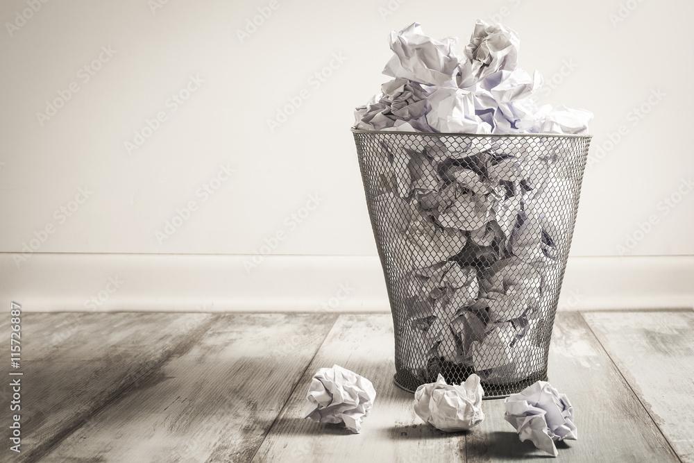 Fototapeta Crumpled paper in the trash can