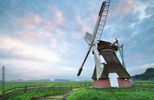 Poster Molens Dutch windmill at summer sunrise