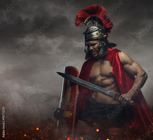 Fényképezés  Male in spartan costume holding sword and shield.