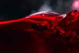 Red wine on black background