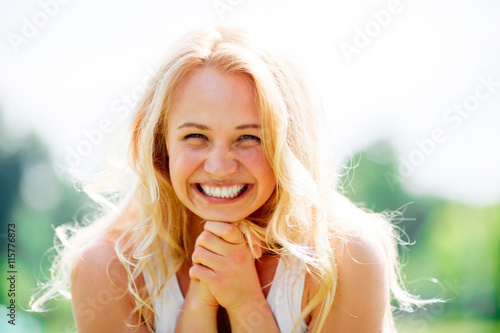 Fotografie, Obraz  Portrait of blonde model with wavy hair put her head in  arms