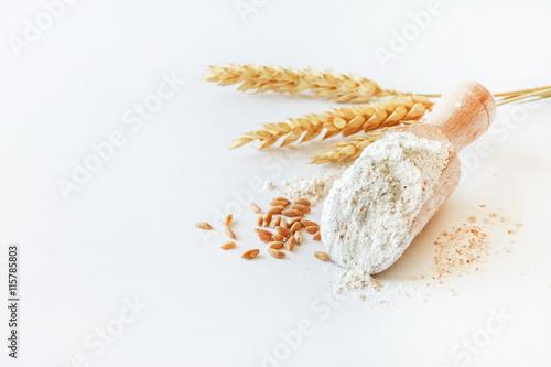 Fototapeta wholemeal flour in wooden spoon obraz