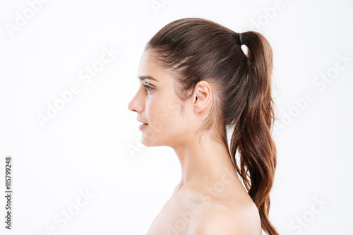 Fotografía  Profile of attractive young woman with ponytail