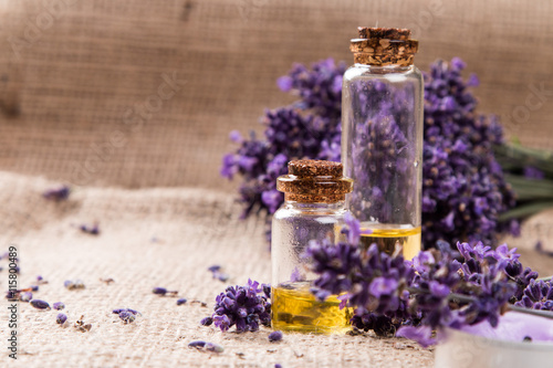 Photo  spa massage setting, lavender product, oil on wooden background