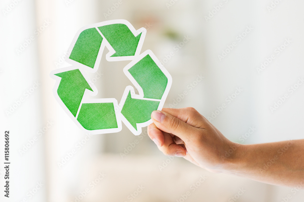Poster Foto Close Up Of Hand Holding Green Recycle Symbol Koop Op