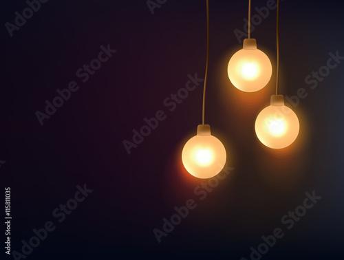 Three decorative light bulbs hanging against dark background Wall mural