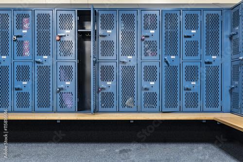 Obraz na plátne Locker room with blue cage lockers