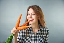 Beautiful Girl Eating Carrot O...