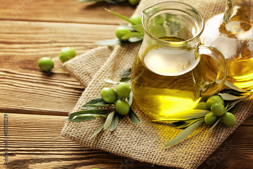 olive oil bottles on wooden table