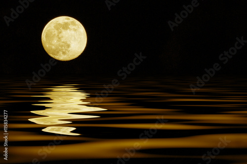 yellow moon over sea