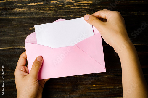 Fotografia, Obraz  Pink envelope and blank white card holding by hand