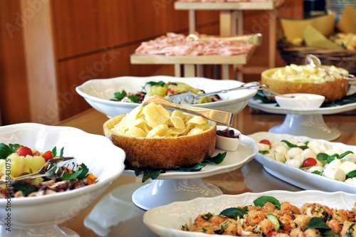 Variety of meat, fish and side dishes on a buffet