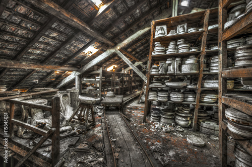 Obraz Shelves of clay moulds at an abandoned ceramics factory - fototapety do salonu