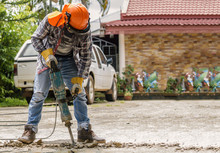 Workers Use Concrete Breaker Electric