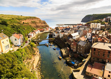 STAITHES, ENGLAND - JULY 12: View Of Staithes, From A High Viewpoint, Showing The Beck And The Town. In Staithes, North Yorkshire, England. On 12th July 2016.