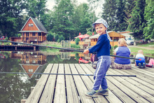 Young Boy Fishing From Dock