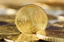 Ten Euro Cent Standing Between Other Coins
