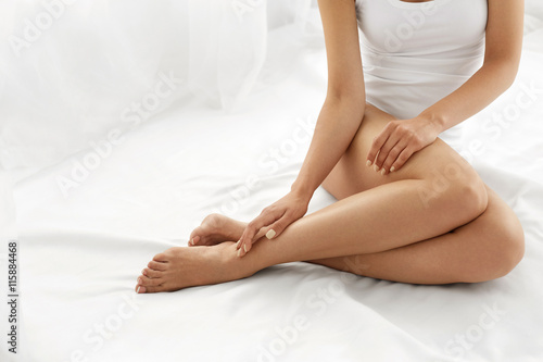 Canvas-taulu Hair Removal. Close Up Woman Hands Touching Long Legs, Soft Skin