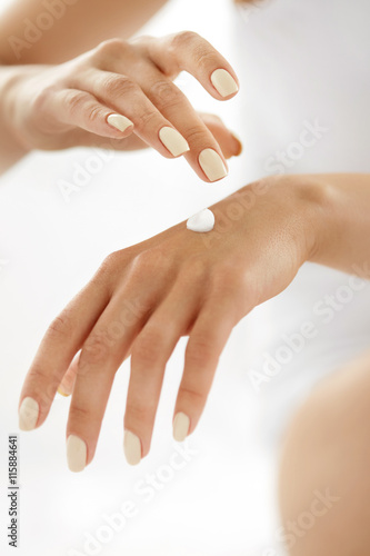 Poster  Woman Hands With Cream. Closeup Of Female Hands Applying Lotion