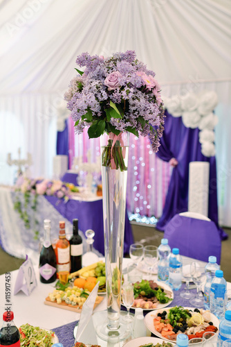 Fototapety, obrazy: Beautiful wedding restaurant for marriage. White decor for bride and groom. Colorful decoration for celebration. Beauty bridal interior. Bouquet, food and flowers in hall