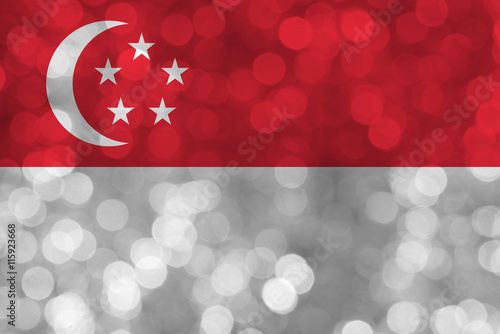 Photo  Singapore flag over bokeh background with copy space,  Independence day greeting