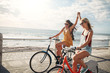 canvas print picture - Female friends enjoying cycling on a summer day