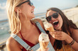 canvas print picture - Two best friends having ice cream together outdoors