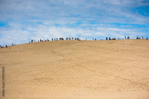 Foto op Aluminium Blauw People visiting the highest sand dune in Europe Dune of Pyla