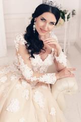 Naklejka fashion interior photo of gorgeous bride in luxurious wedding dress with accessories