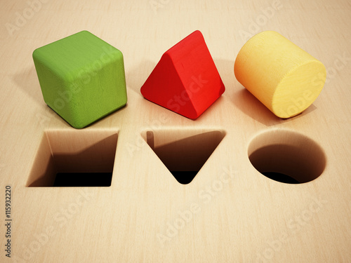 Fotografie, Obraz  Cube, prism and cylinder wooden blocks in front of holes