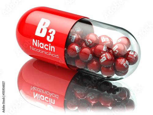 Fototapeta Vitamin B3 capsule. Pill with Niacin or nicotinic acid. Dietary obraz