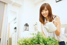Young Japanese Woman Watering ...