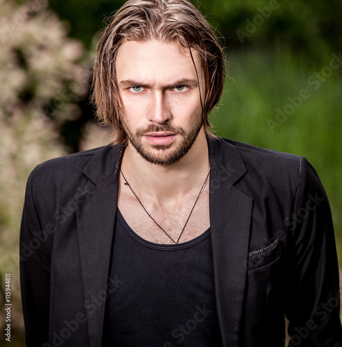 Fényképezés  Elegant handsome man poses outdoor.