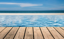 Wooden Floor With Infinity Pool On Beach Background