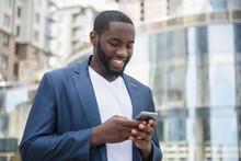 African Businessman Messaging ...
