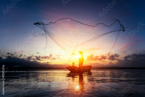Valokuva  Silhouettes of the traditional fishermen at the sunset near Galle in Sri Lanka