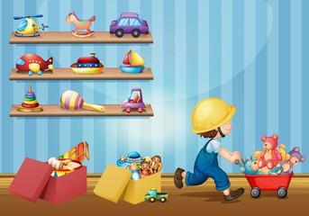 fototapeta chłopiec bawi się zabawkami w pokoju