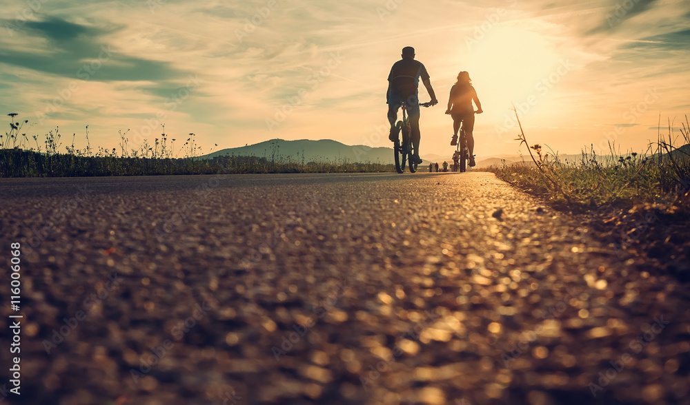 Fototapety, obrazy: Cyclists are on the sunset road