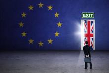 Male Worker Looking At Brexit Door