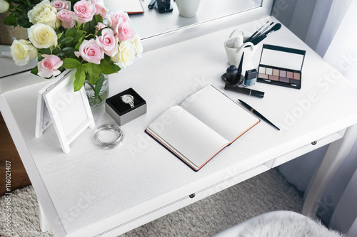 Cosmetic and notebook on light dressing table Fototapet