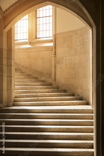 Light Shining Through Windows Onto Stone Stairs Stairway Staircase Under A Gothic Archway Ivy League