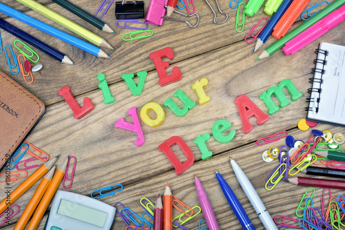 Fotografie, Obraz  Live your dream text on wooden table