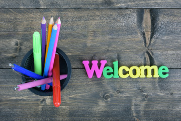 Welcome on wooden table