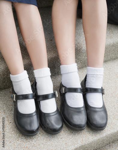900d6decbf98 Asian Thai girls schoolgirl student feet with black leather shoes as a  school uniform. It