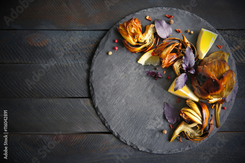 Baked artichokes with spices on wooden background Wallpaper Mural