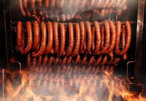 Delicious homemade sausage in the smokehouse Fototapeta